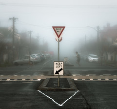 Jogger in the Mist (Dr Abbate) Tags: road street urban mist sign fog square day suburban cloudy running jogging jogger