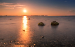 Golden hour light (Stefan Sellmer) Tags: sunset beach water reflections germany de deutschland outdoor stones bluesky stein kiel goldenhour schleswigholstein laboe balticcoast