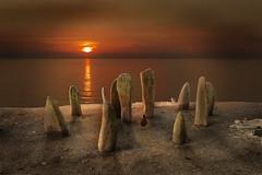 Amanecer sin tiempo (Inmacor) Tags: light red lake sol sunrise lago agua time amanecer piedras tiempo pasado inmacpr