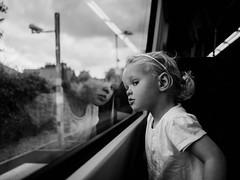 Train Reflections (Murray McMillan) Tags: light white black monochrome train mono natural candid olympus f18 17mm penf