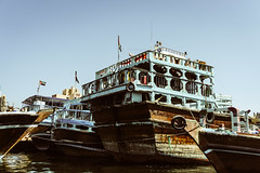 Dhows in Dock (Bartholomew K Poonsiri) Tags: travel sky water creek boat dock asia dubai outdoor uae middleeast wideangle trade dhow sonyepz1650mmf3556oss sonyilce6000