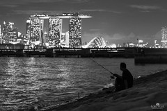 Anglerfish (kiatography1) Tags: street people urban blackandwhite white man black streets men monochrome silhouette marina bay town seaside fishing singapore waves fishermen emotion bokeh sony cityscapes hobby 55mm figure fisher lone rod cbd f18 streetscapes mbs breakwater centralbusinessdistrict anglers marinabay loneman a7r gardensbythebay marinabaysands