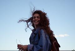 DSC_0326 (noemi.filetti) Tags: blue portrait sky italy girl hair windy sunny bluejeans