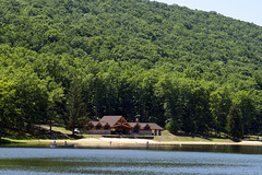The beach house is between the lake and a mountain at Poe Valley State Park, Pennsylvania (Pennsylvania State Parks) Tags: lake beach canoe boating poe valley state parks pennsylvania visitpaparks