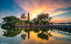 Tran Quoc pagoda in the sunset (:: Focus Studio ::) Tags: china city travel autumn winter light sunset sky cloud sunlight lake holiday west reflection tree tower heritage history tourism nature water beautiful japan skyline landscape asian thailand pagoda seaside pond asia vietnamese quiet peace waterfront bright outdoor turtle buddha capital religion culture peaceful sunny unesco vietnam shore sword romantic myanmar tradition hanoi hue saigon tran indochina quoc