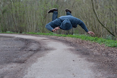 Falling.. (ClaudiaJR) Tags: road trees man black forest concrete hoodie levitation