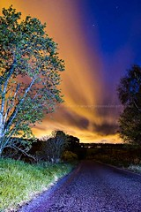 That ain't the Northern Lights (amcgdesigns) Tags: road blue trees sky orange black colour tree green grass yellow night clouds canon dark stars landscape eos lights scotland weird highlands lowlight colours arty unitedkingdom perspective may scottish places local distance drama atmospheric moray lightroom forres cs4 hiiso rafford eos7d cloudsstormssunsetssunrises lightroom4 andrewmcgavin ©andrewmcgavin