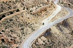 the road home (overthemoon) Tags: road mountain man landscape desert tunisia pass donkey fork pylon wires shrub hillside arid turning tunisie gettyimages tunesien matmata turnoff southtunisia