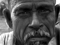 Cowman Ulundurpetai ([PKPC]) Tags: old morning light portrait people blackandwhite bw india black eye blanco face silhouette contrast dark photography mono cow photo blackwhite milk interesting eyes noir village image noiretblanc retrato farm indian innocent naturallight portrt human innocence farmer common blanc oldage tamil tamilnadu southindia lightart faccia contrasted humanspirit darkman cowman indianvillage indianman lightdance indianmen indianfarmer incredibleindia pkpc blackandwihite faceonly ulundurpet villupuramdistrict indiabeautiful praveenkumarpalanichamy pkpcphotography pkpcwork