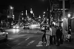 Untitled NYC Street shot. (Explored) (Linh H. Nguyen) Tags: street city people bw white newyork black monochrome night lights chinatown sony grain landmark explored rokkorx5014 nex7