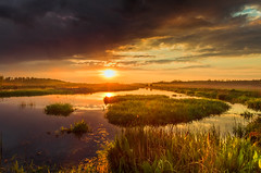 The storm is over now (piotrekfil) Tags: sunset sky sun sunlight storm nature water clouds wow reflections river landscape pentax poland piotrfil