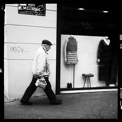 Paris noir series (Nick Kenrick.) Tags: hipstamatic gsquadlens aodlxfilm paris beret candid walking striding france mono streettogs streetphotography noir street hipstography