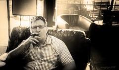 Smokin' in the Boy's Room (evanffitzer) Tags: selfportrait leather dark chairs lasvegas smoke cigar chisel selfie laflordominicana fujifilmx100s enfuegocigars