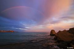 rock where born Rainbow (jopas2800) Tags: sunset sea rock clouds landscape rainbow mediterrneo nikond610
