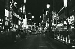 Street Scene - Busan (Shoji Kawabata. a.k.a. strange_ojisan) Tags: street city nightphotography film night analog 35mm dark japanese asia cityscape fuji streetphotography cityscapes delta s korea east busan streetphoto nightphoto 3200 ilford analogphotography klasse eastasia analogphoto filmphotography filmphoto