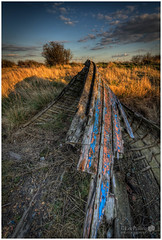 When The Bow Breaks (LeePellingPhotography.co.uk) Tags: wood blue light sky cloud tree green pool grass creek boat wooden ship stones lee bow wreck faversham shaddows pelling