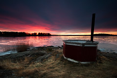 Hot tub (- David Olsson -) Tags: morning winter lake cold colour ice reed water clouds sunrise reflections landscape dawn march early frozen nikon rocks desert cloudy sweden empty tripod vivid sigma nopeople filter hottub colourful 1020mm grad 1020 hitech vnern 2012 dx hammar vrmland drygrass lakescape gnd bythelake skoghall badtunna d5000 davidolsson trumman 09hard ginordicmar12 trummafiskehamn