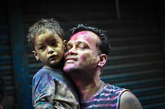 The Love of a Father for His Son (Samy Abdul Wahed) Tags: life portrait love smile photography nikon colorful father joy lifestyle happiness son best relationship dhaka nikkor holi bangladesh flicker nikond5000 nikkor18g lookingbacktowards
