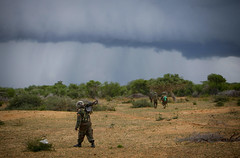 "AMISOM and Somali Troops on Second Day of ""Operation Free Shabelle"" (United Nations Photo) Tags: storm rain clouds army military gray photojournalism unitednations uganda officer troop somalia unphoto thicket sna afgooye shabelle amisom alshabaab"