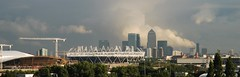2012 Olympic site under construction with fire in the distance, Canary Wharf & Other Towers, Docklands, East London, England. (Joseph O'Malley64) Tags: england london stadium wharf docklands canary olympics stratford 2012