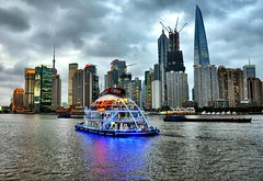 Shanghai at Dusk (Explore) (missgeok) Tags: china lighting city sky water ferry composition buildings reflections lights boat day mood colours nightscape shanghai nightshot cloudy dusk sightseeing popular gettyimages cityskyline flickrvision huangpuriver wetreflections touristdestination pudongskyline shanghaiatdusk