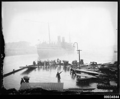 Passenger vessel, possibly SS MOOLTAN III, leaving the P&O wharf in Sydney Cove, 1920-1935