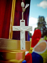 Plastic crucifix (Vorona Photography) Tags: usa cemetery field closeup america religious washington close view state pacific northwest surrealism united plastic crucifix tacoma states depth imagery symbolism calvary whirligig blurism