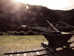 The Pit Wagon (Steve Taylor (Photography)) Tags: bridge newzealand brown white green metal truck wagon spring mine track glow glare railway pit tub lensflare nz southisland curve