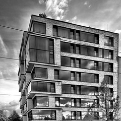 Modern Construction (ANBerlin) Tags: street city sky urban bw white black reflection building berlin apple monochrome berg architecture modern clouds germany deutschland blackwhite construction gray himmel wolken grau moderne east stadt architektur sw eastside reflexion mitte gebude schwarz extraordinary ost futuristic reflektion mauerpark iphone prenzlauer hausbau weis futuristisch stdtisch bernauer strase iphotography anb030 iphonography ausergewhnlich bernauerstrase bernauerstreet iphone6s 6splus natulisliving
