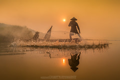 Fisherman Touchdown (noomplayboy) Tags: travel sunset shadow people sun reflection sunrise asian thailand fisherman asia outdoor country thai universe fishery noomplayboy nanutbovorn