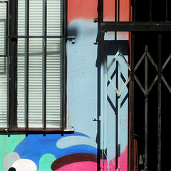 coloring outside the lines (msdonnalee) Tags: window gate venetianblinds abstractreality spraypaintedwall