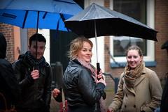 Regenlach (Arend Jan Wonink) Tags: leeuwarden fryslan friesland regen rain straatplaat streetphotography youngwoman jongevrouw woman vrouw umbrella paraplu nederland netherlands nikon nikond60 arendjanwonink