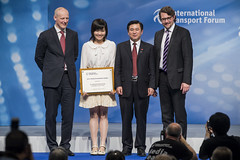 Young Researcher of the Year Award recipient Dr. Wing Yee Winnie Lam stands next to Michael Kloth, Zhenglin Feng and Andreas Scheuer at the Summit