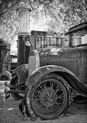 Ford Model A at the Gas Pump, Laws, CA (4 Corners Photo) Tags: california blackandwhite ford abandoned car modela vintage rust automobile unitedstates antique spokes grill gasstation tires machinery northamerica ghosttown hood rim gaspump laws owensvalley inyocounty canoneos50d