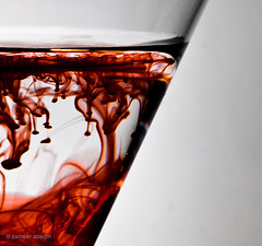 Seeing Red (startwithz) Tags: red macro water glass droplets nikon d70 dye foodcoloring strobist
