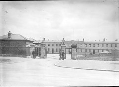 Military Barracks at 11.07 a.m., but where? Garda Headquarters in the Phoenix Park, that's where! (National Library of Ireland on The Commons) Tags: 1920s ireland dublin clock police soldiers ric flagpole guards barracks railings lawenforcement 1107 constable phoenixpark glassnegative leinster constabulary militarybarracks nationallibraryofireland royalirishconstabulary gardaheadquarters fergusoconnor locationidentified fergusoconnorcollection