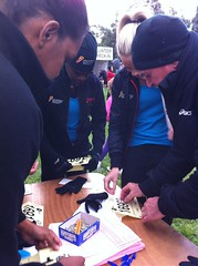 "Rob showing the girls how to attach their race bibs • <a style=""font-size:0.8em;"" href=""https://www.flickr.com/photos/64883702@N04/7194271204/"" target=""_blank"">View on Flickr</a>"