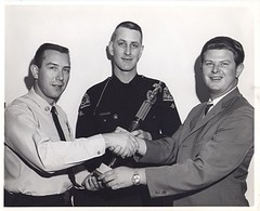 2 policemen & a civilian shaking hands over a trophy (South Pasadena Public Library Local History) Tags: police southpasadena policedepartment sppl sppd southpasadenapubliclibrary southpasadenalocalhistory