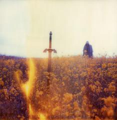 (theonlymagicleftisart) Tags: selfportrait polaroid sx70 magic flames fantasy link sword zelda cloak expired timezero mastersword