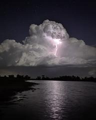 Storm Cloud (joshgreen26) Tags: cloud storm reflection water night stars pond long exposure ks bolt kansas lightning
