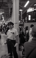 How far is home? (SandoCap) Tags: street film monochrome station japan 50mm tokyo shinjuku trix platform 400tx transit commute    mil   canonp   summitar   japaninbw