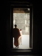 At the door... (phil.photo61) Tags: travel orange monk meditation ankgor cambodgia