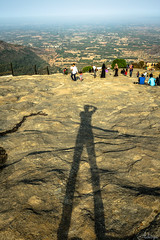 Standing tall on Nandi Hills.... (Aditya Chandra) Tags: shadow sky people india heritage me stone clouds canon landscape ancient outdoor bangalore perspective scenic tourist karnataka cloudporn hillstation nandihills skyporn chikkaballapur