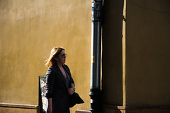Passing by The Yellowness (prulka) Tags: street city light shadow urban woman streetart color colors girl fashion yellow composition contrast photography nikon fashionphotography streetphotography clarity poland sharp capture cracow lightandshadow simplebeauty yellowness contrastive nikonphotography simplephotography