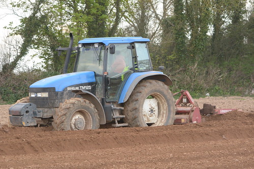 New Holland TM125 Tractor with a Reekie Bed Tiller