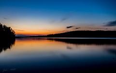 Midnight (Jani Mkel) Tags: blue sunset sky orange lake reflection nature silhouette sunrise canon finland lens landscape island photography eos dawn reflecting perfect soft long exposure skies view purple sundown image dusk horizon dream wideangle calm clear shore midnight finnish pijnne longexpo 700d