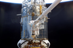 Astronauts James H. Newman and Michael J. Massimino EVA