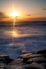 Into the Sun (John Cothron) Tags: ocean cloud seascape beach water rock seashells sunrise 35mm canon landscape dawn spring twilight sand florida scenic wave windy atlanticocean saltwater ze seafoam lightrays calcite sunshinestate coquina palmcoast flaglercounty washingtonoaksgardensstatepark johncothron 5dmkii cothronphotography zeissmakroplanart250mmze 2jtrip20121 johncothron img09400120407