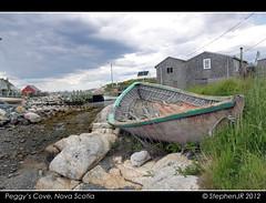 Lonely row boat in Peggy's Cove (StephenJR) Tags: ocean sea canada abandoned broken rain clouds reeds grey boat rocks skies novascotia village cove row atlantic rowboat peggys peggyscove 2012 pub1 2013