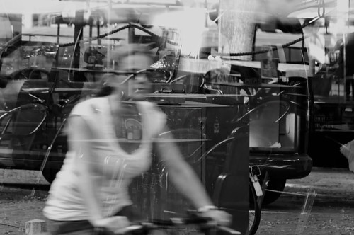 Cyclist caught in the reflecting glass  DSC5516